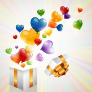 Colored heart shaped balloon with gift box vector free